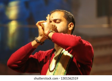 Varanasi, India, January 21,2019: Hindu priest blowing holy conch shell as part of Ganga aarti ritual at Dashashwamedh Ganges river ghat Varanasi India