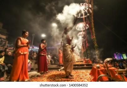 Varanasi, India, January 21,2019: Hindu priests perform Ganga aarti ritual ceremony at Dashashwamedh Ganges river ghat at Varanasi India