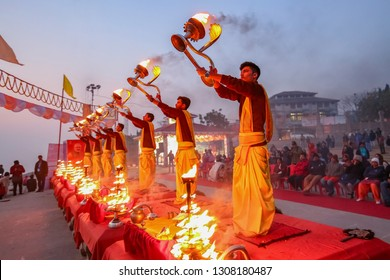 Varanasi, India, January 22, 2019: Varanasi Ganga aarti rituals at Assi ghat performed by young priests before sunrise at the Ganges river ghat at Varanasi India.