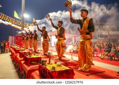 Varanasi, India, January 22, 2019: Young Hindu priests perform traditional Ganga aarti ceremony rituals with fire before sunrise at the Ganges river bank at Varanasi, India.