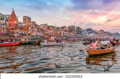 Varanasi, India, January 23,2019: Dashaswamedh Ganges river ghat Varanasi at twilight with tourists enjoying boating rides