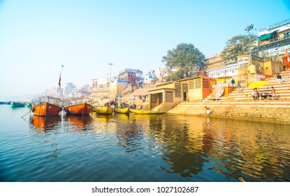 VARANASI INDIA - January 25, 2018: Unidentified people visit Ganges river ghat in Varanasi.
