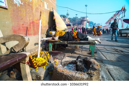 VARANASI INDIA - January 25, 2018: Unidentified Hindu priest and people visit Ganges river ghat in Varanasi.