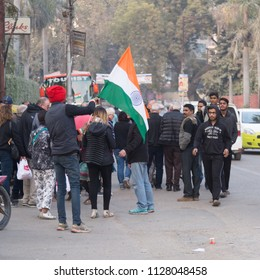 Varanasi, India - January 26, 2018: Local people celebrates Republic Day by waving flags and decorating flags along streets to honour the date on which the Constitution of India came into effect