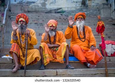 Varanasi, India - January 7, 2019 : THREE SADHUS GIVING BLESSING AT DASHASHWAMEDH GHAT