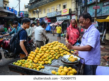 Varanasi, India - Jul 11, 2015. Vendors selling fresh mango fruits at old market in Varanasi, India. Varanasi draws Hindu pilgrims who bathe in the Ganges River sacred waters.
