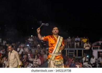 Varanasi / India - July 15 2019: Hindu rituals in the evening in the holy city next to the Ganges river.