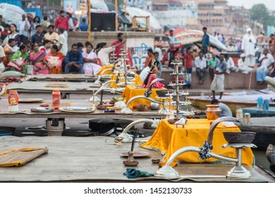 Varanasi / India - July 15 2019: Preparations of different religious artefacts before the evening prayer ritual in the holy city of Varanasi
