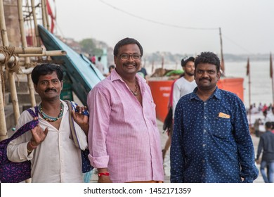Varanasi / India - July 15 2019: A group picture of some Indians visiting the holy city of Varanasi on a sunny afternoon.