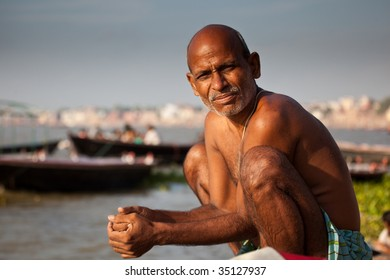 VARANASI, INDIA - JULY 22: Man bathe at the edge of the Ganges after a solar eclipse taking advantage of the river's purifying powers on the auspicious day July 22, 2009 in Varanasi, India.