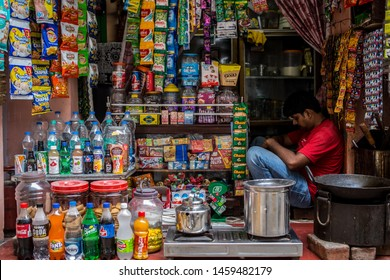Varanasi / India - July 23 2019: A store owner sleeps in his small shop in downtown Varanasi on a early morning.