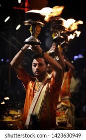 Varanasi / India - June 2019: Varanasi (Banaras) Ganga aarti ceremony rituals performed by Hindu priests in evening at Dashashwamedh Ghat in Varanasi Uttar Pradesh India