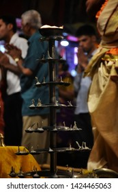 Varanasi / India - June 2019: Varanasi (Banaras) Ganga aarti ceremony rituals performed by Hindu priests in evening at Dashashwamedh Ghat Varanasi. Closeup of beautiful fire candles for Ganga ceremony