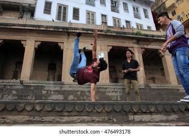 VARANASI, INDIA- MAR 13:Unidentified young men do acrobatics on the ghats of river Ganges on March 13, 2016 in Varanasi, Uttar Pradesh, India.Varanasi is the most popular pilgrim place in India.