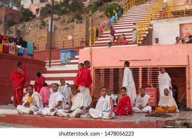 VARANASI, INDIA - MAR 20, 2018: Banks on the holy Ganges river in the early morning. According to legends, the city was founded by God Shiva about 5000 years ago.
