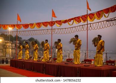 VARANASI, INDIA - MAR 20, 2018: Hindu priests perform Agni Pooja (Sanskrit: Worship of Fire) on Dashashwamedh Ghat - main and oldest ghat of Varanasi located on the Ganges.