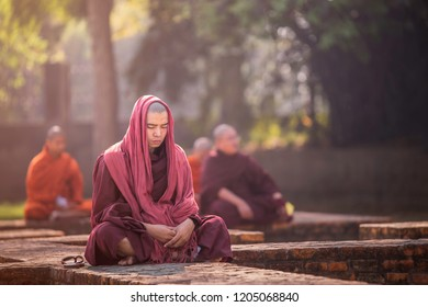 VARANASI, INDIA – MARCH 24: Nepalese monks are meditating inside the temple. This is the first temple in Buddhism. The yellow cloth cover the head on March 24, 2018 in Varanasi, India.