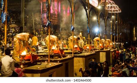 Varanasi, India - May 06, 2019 - Varanasi Ganga aarti rituals at Dashashwamedh ghat performed by young priests daily after sunset at the Ganges river