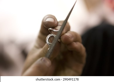 VARANASI, INDIA - MAY: Unidentified Jeweler Making Jewelry (ring). Handwork. May 15, 2015 in Varanasi, India. According to legend, Varanasi was founded by Lord Shiva