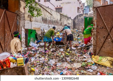 Varanasi, India - Nov 13, 2015. Garbage being dumped and stored in a vacant downtown residential lot, raising issues of city waste management and public health.
