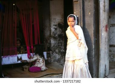 VARANASI, INDIA - NOV 14, 1999- Young Muslim girl in the silk weaving district of Varanasi,  India , Asia