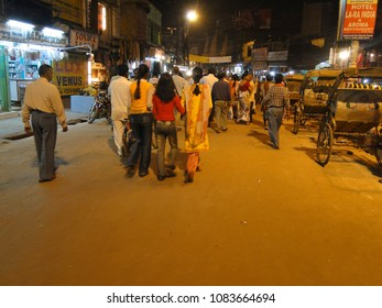 VARANASI, INDIA - NOV 5, 2009 - People visit the night market shops near the ghats of in Varanasi, India.