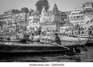 Varanasi, India - November 15, 2013: Man sailing on the boat on Ganges river during Kumbh Mela festival  on November 15, 2013