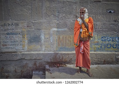 Varanasi, India, November 2015. A Sadhu standing in a Ganges river ghat.
