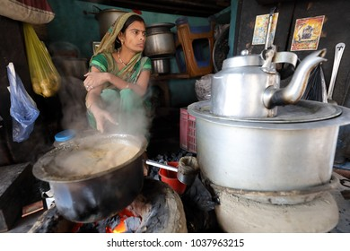 VARANASI - INDIA - NOVEMBER 26, 2017: Unidentified Hindu woman sells tea in a traditional tea stall on November 26, 2017 in Varanasi, India. Varanasi is the holiest of the seven sacred cities in India