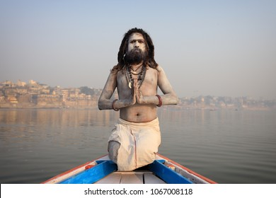 VARANASI - INDIA - NOVEMBER 28, 2017: Unidentified Aghori sadhu (holy man) on a boat on the Ganges on November 28, 2017 in Varanasi, India. Varanasi is the holiest of the seven sacred cities in India.