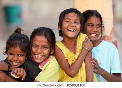 VARANASI - INDIA - NOVEMBER 30, 2017: Unidentified girls have fun at the ghats of Varanasi on November 30, 2017 in Varanasi, India. Varanasi is the holiest of the seven sacred cities in India.