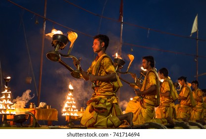 Varanasi, India, October 13, 2017: Varanasi morning Ganga aarti rituals performed by young priests before sunrise at the Ganges river ghat at Varanasi India.