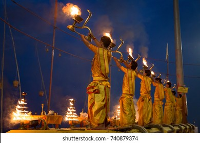 Varanasi, India, October 13,2017: Hindu priests perform the holy Ganga aarti ceremony rituals with holy fire before sunrise at the Ganges river bank at Varanasi, India.