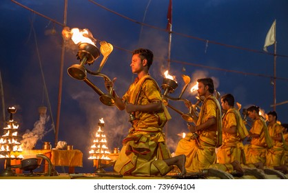 Varanasi, India, October 13,2017: Young priests perform the holy Ganga aarti ceremony rituals at dawn at the Ganges river bank at Varanasi, India.