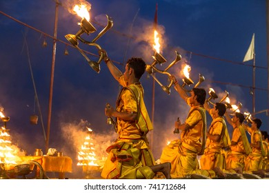 Varanasi, India, October 14,2017: Hindu priests perform the holy Ganga aarti ceremony rituals with holy fire before sunrise at the Ganges river bank at Varanasi, India.