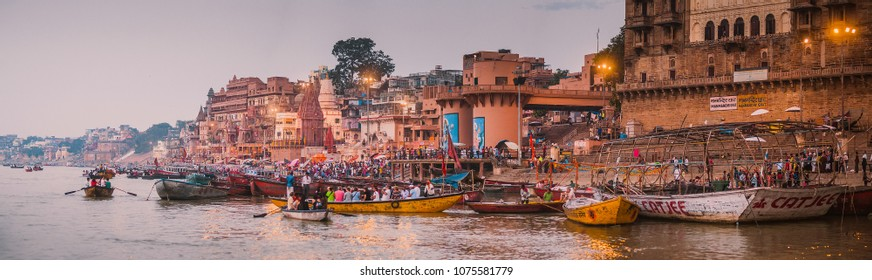 VARANASI, INDIA - October 24, 2017 : Morning view of Ganges river in Varanasi, India. Ghats with boats and people. Popular landmark