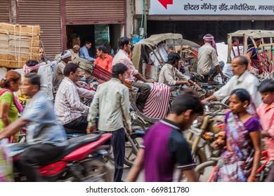 VARANASI, INDIA - OCTOBER 25, 2016: Traffic on a busy crowded street in Varanasi, India