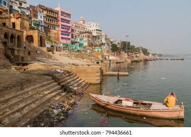 VARANASI, INDIA - OCTOBER 25, 2016: View of Lal Ghat (riverfront steps) of sacred river Ganges in Varanasi, India