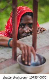 Varanasi, India - OCTOBER 26 2017: An unidentified beggar women begs for money