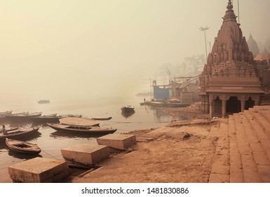 VARANASI, INDIA: Sunrise in misty indian city with monumental temples and riverboats in Ganga river on January 4, 2019. The 2,525 km river rises inthe Indian state Uttarakhand, flows into Bangladesh