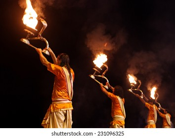 VARANASI, INDIA-02 OCT:A Hindu priest performs the Ganga Aarti ritual on 02 Oct, 2014 in Varanasi.Fire puja is a Hindu ritual that takes place at Dashashwamedh Ghat on the banks of the river Ganges