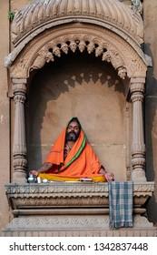 Varanasi, India-January 18, 2019: Indian sadhu meditates in a temple near Ganges river in Varanasi.