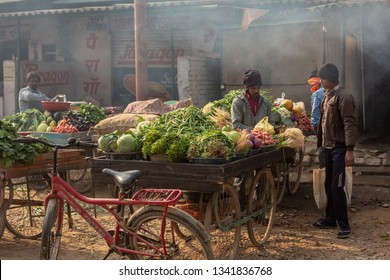 Varanasi, India-January 19, 2019: Indian street food vendors selld vegetables and fruits in a village near Varanasi