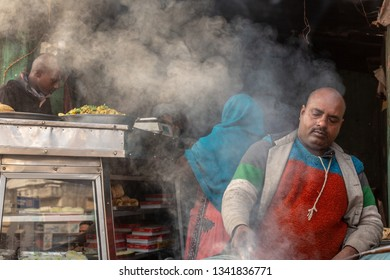 Varanasi, India-January 19, 2019: Indian street food vendors cooks traditional and delicious foods for snack