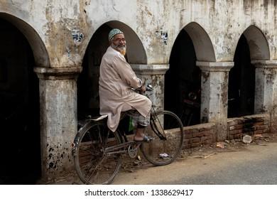 Varanasi, India-January 19, 2019: Portrait of traditionally dressed man in the streets of rural areas of Varanasi.