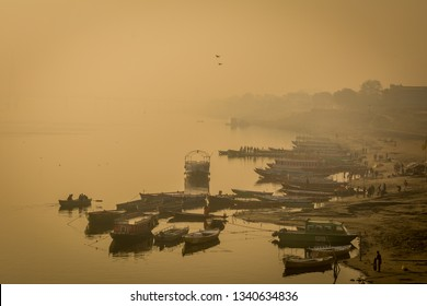 Varanasi, January 9, 2019 - TOURIST BOATS ARE ANCHORED AT ASSI GHAT ON A FOGGY WINTER MORNING