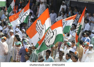 VARANASI - MAY 10: Congress party flags flying high during a road show  to support local Congress candidate Mr. Ajay Rai on May 10, 2014 in Varanasi , India.