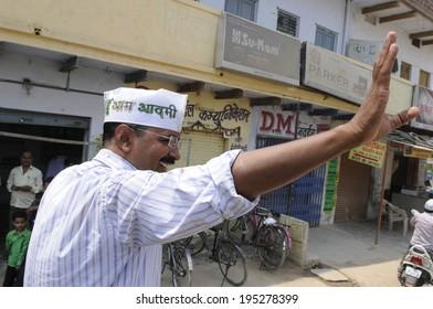 VARANASI - MAY  4 : Arvind kejriwal  waiving his hand towards his voters  during a political meeting on May 4 , 2014 in Varanasi , India.