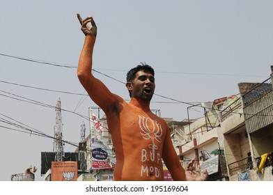 VARANASI - MAY 8:  A BJP supporter with his whole body painted in saffron colour on May 8, 2014 in Varanasi , India.