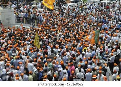 VARANASI - MAY 8:  BJP supporters thronging the streets on May 8, 2014 in Varanasi , India.